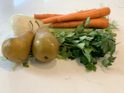pears, carrots, and greens ready for juicing