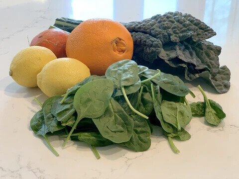 spinach, oranges, lemons, and kale