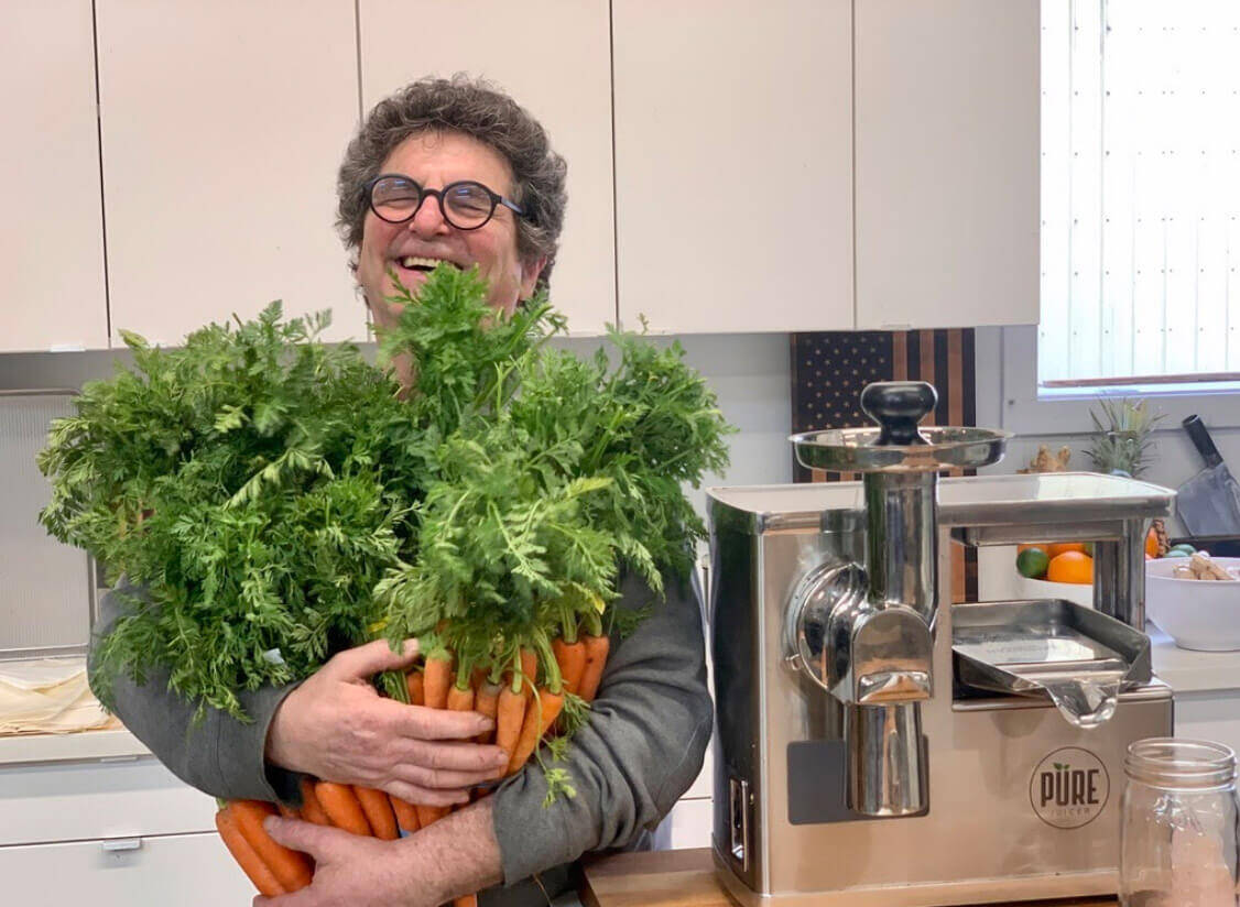 David Feinberg holding carrots