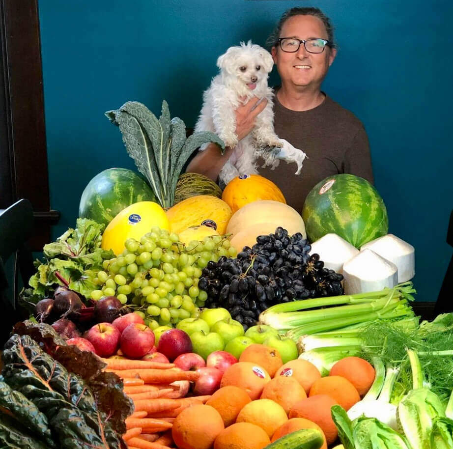 Brett with dog and fruit and veggies