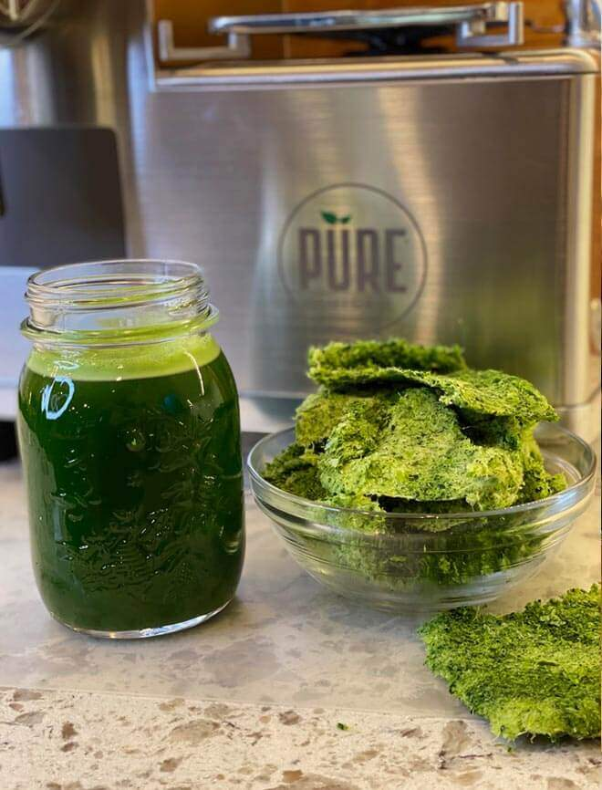Green juice in front of PURE Juicer