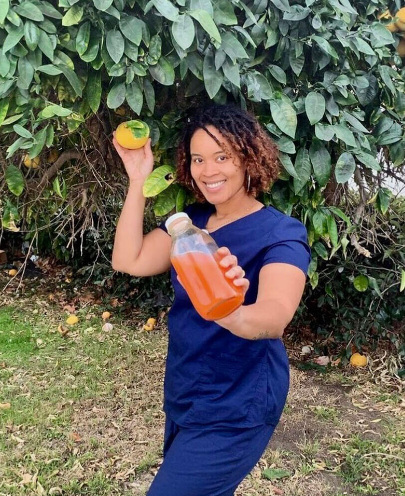 Kia holding fruit and juice