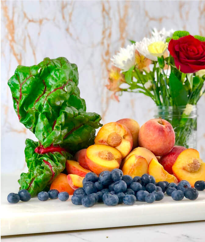 kale, peaches, and blueberries